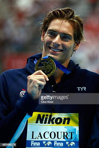 Gold medallist Camille Lacourt of France poses during the medal ceremony for the Men's 50m Backstroke Final on day sixteen of the 16th FINA World...