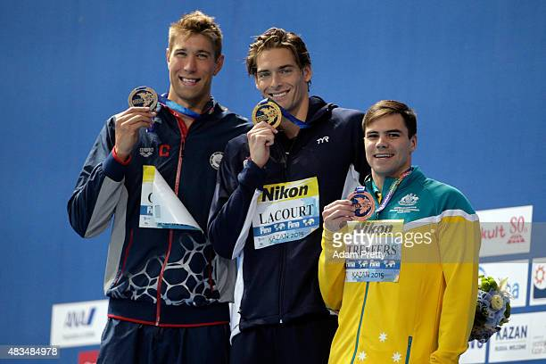 Gold medallist Camille Lacourt of France poses with silver medallist Matt Grevers of the United States and bronze medallist Ben Treffers of Australia...