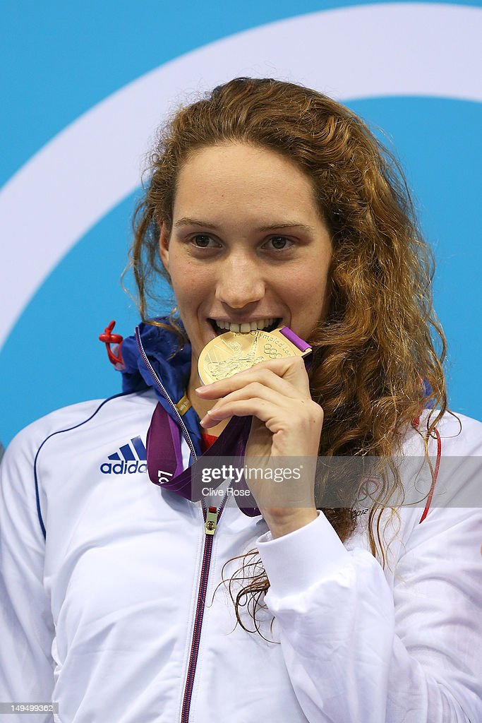 Gold medallist Camille Muffat of France poses on the podium during the medal ceremony following the Women's 400m Freestyle final on Day 2 of the London 2012 Olympic Games at the Aquatics Centre on July 29, 2012 in London, England.