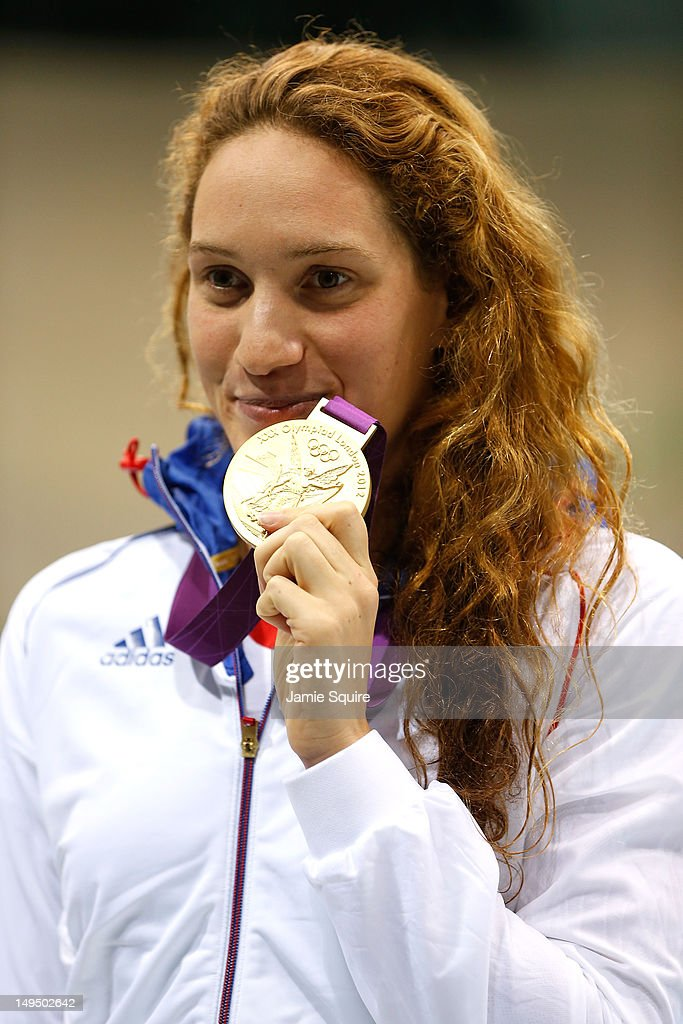 Gold medallist Camille Muffat of France poses with the medal won in the Women's 400m Freestyle final on Day 2 of the London 2012 Olympic Games at the...