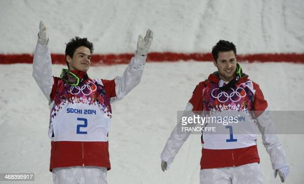 Gold Medallist Canada's Alex Bilodeau and Silver Medallist Canada's Mikael Kingsbury celebrate on the podium at the Men's Freestyle Skiing Moguls...