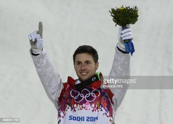 Gold Medallist Canada's Alex Bilodeau celebrates on the podium at the Men's Freestyle Skiing Moguls Flower Ceremony at the Rosa Khutor Extreme Park...