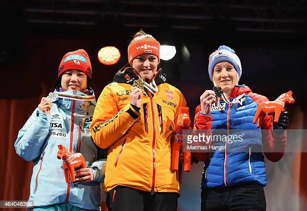 Gold medallist Carina Vogt of Germany poses with silver medallist Yuki Ito of Japan and bronze medallist Daniela IraschkoStolz of Austria during the...