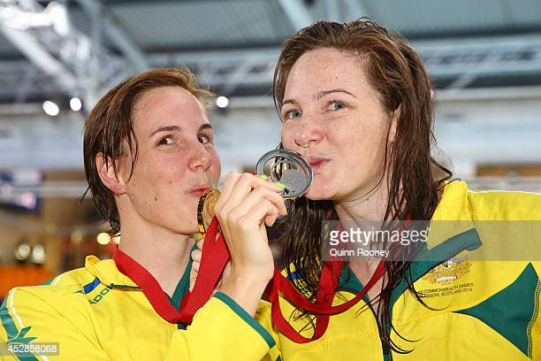 Gold medallist Cate Campbell of Australia poses with silver medallist Bronte Campbell of Australia after the medal ceremony for the Women's 100m...