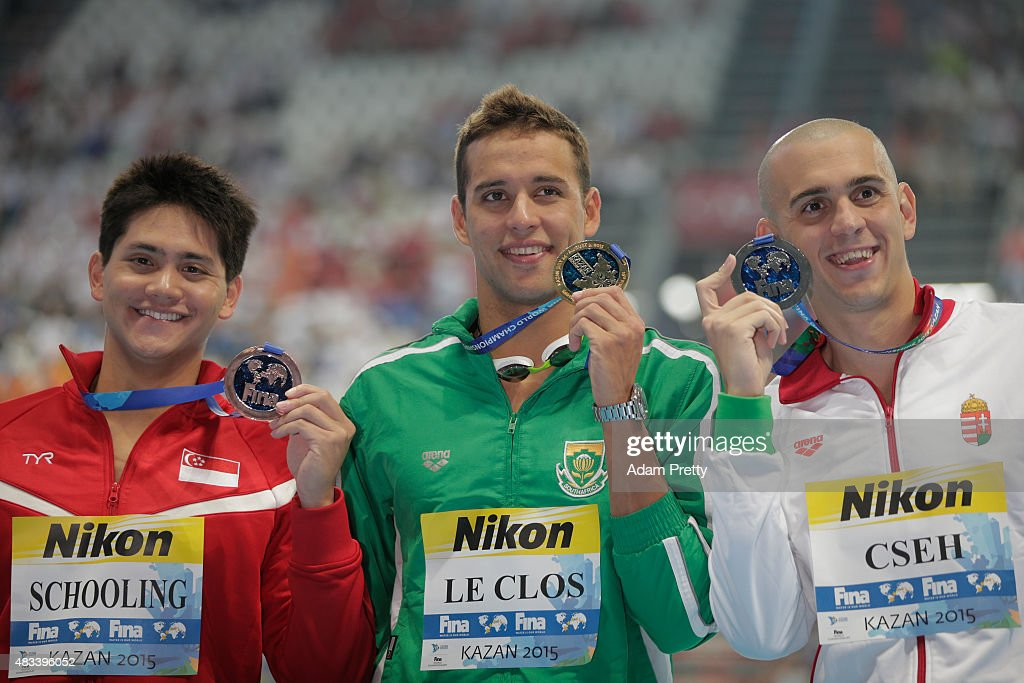 Gold medallist Chad Le Clos of South Africa poses with silver medallist <a gi-track='captionPersonalityLinkClicked' href=/galleries/search?phrase=Laszlo+Cseh&family=editorial&specificpeople=873105 ng-click='$event.stopPropagation()'>Laszlo Cseh</a> of Hungary and bronze medallist Joseph Isaac Schooling during the medal ceremony for the Men's 100m Butterfly Final on day fifteen of the 16th FINA World Championships at the Kazan Arena on August 8, 2015 in Kazan, Russia.
