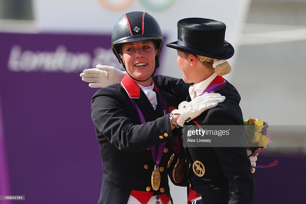 Gold medallist Charlotte Dujardin of Great Britain riding Valegro and Laura Bechtolsheimer of Great Britain riding Mistral Hojris celebrate with...