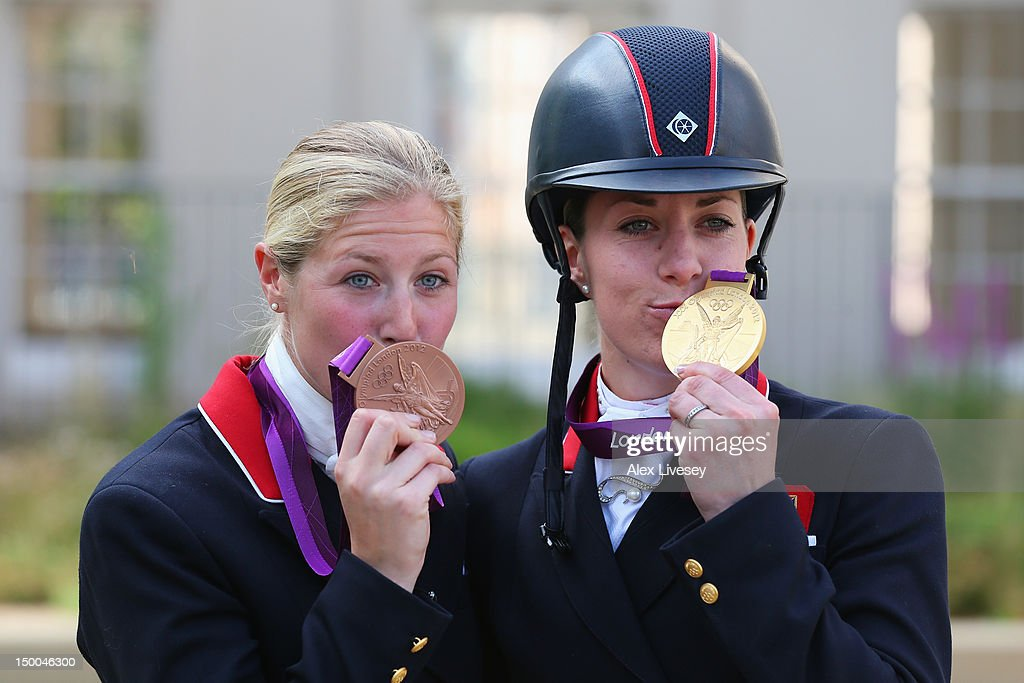 Gold medallist Charlotte Dujardin of Great Britain riding Valegro and bronze medallist Laura Bechtolsheimer of Great Britain riding Mistral Hojris...