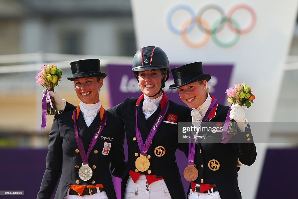 Gold medallist <a gi-track='captionPersonalityLinkClicked' href=/galleries/search?phrase=Charlotte+Dujardin&family=editorial&specificpeople=5426239 ng-click='$event.stopPropagation()'>Charlotte Dujardin</a> (C) of Great Britain riding Valegro, silver medallist <a gi-track='captionPersonalityLinkClicked' href=/galleries/search?phrase=Adelinde+Cornelissen&family=editorial&specificpeople=5427385 ng-click='$event.stopPropagation()'>Adelinde Cornelissen</a> of Netherlands riding Parzival and Laura Bechtolsheimer of Great Britain riding Mistral Hojris celebrate with their medals during the medal ceremony following the Individual Dressage on Day 13 of the London 2012 Olympic Games at Greenwich Park on August 9, 2012 in London, England.