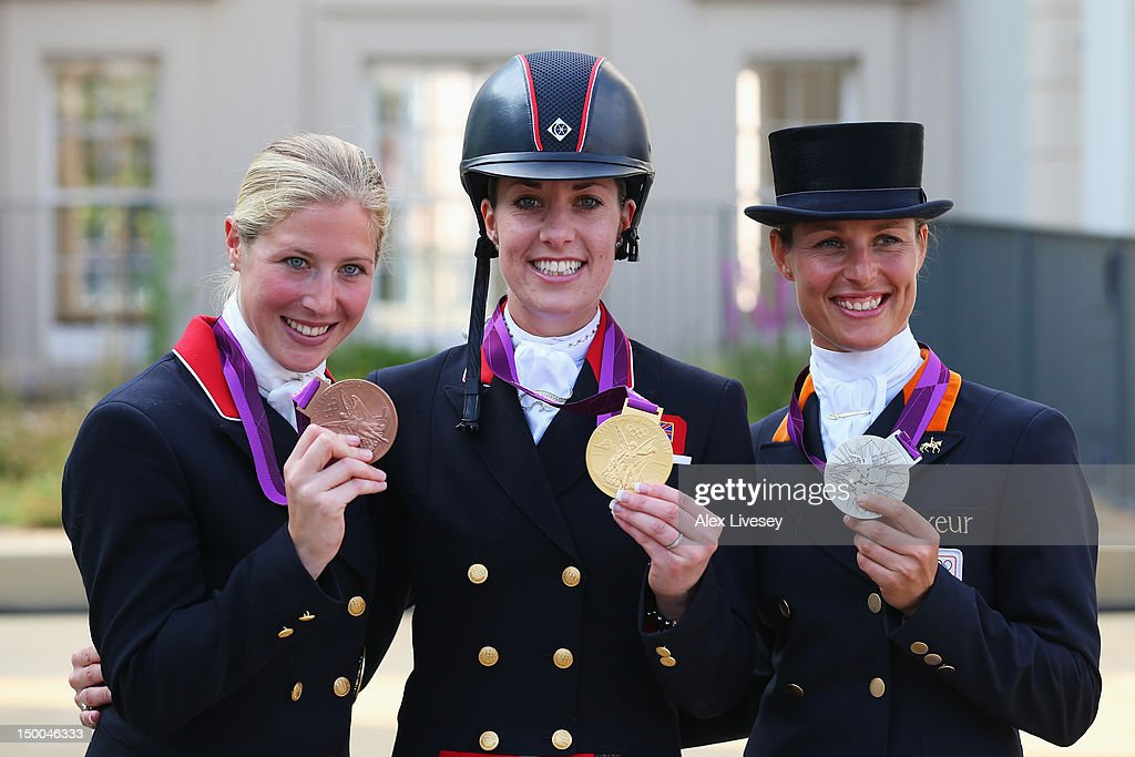 Gold medallist <a gi-track='captionPersonalityLinkClicked' href=/galleries/search?phrase=Charlotte+Dujardin&family=editorial&specificpeople=5426239 ng-click='$event.stopPropagation()'>Charlotte Dujardin</a> (C) of Great Britain riding Valegro, silver medallist <a gi-track='captionPersonalityLinkClicked' href=/galleries/search?phrase=Adelinde+Cornelissen&family=editorial&specificpeople=5427385 ng-click='$event.stopPropagation()'>Adelinde Cornelissen</a> of Netherlands riding Parzival and bronze medallist Laura Bechtolsheimer (L) of Great Britain riding Mistral Hojris pose with their medals following the Individual Dressage on Day 13 of the London 2012 Olympic Games at Greenwich Park on August 9, 2012 in London, England.