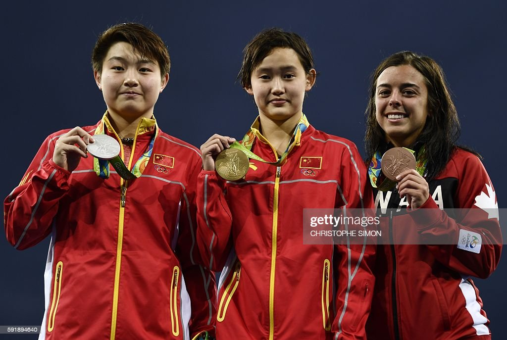 Gold medallist China's Ren Qian poses with silver medallist China's Si Yajie and bronze medallist Canada's Meaghan Benfeito during the podium...