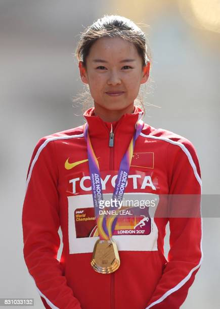 Gold medallist China's Yang Jiayu poses on the podium during the victory ceremony for the women's 20km race walk athletics event at the 2017 IAAF...