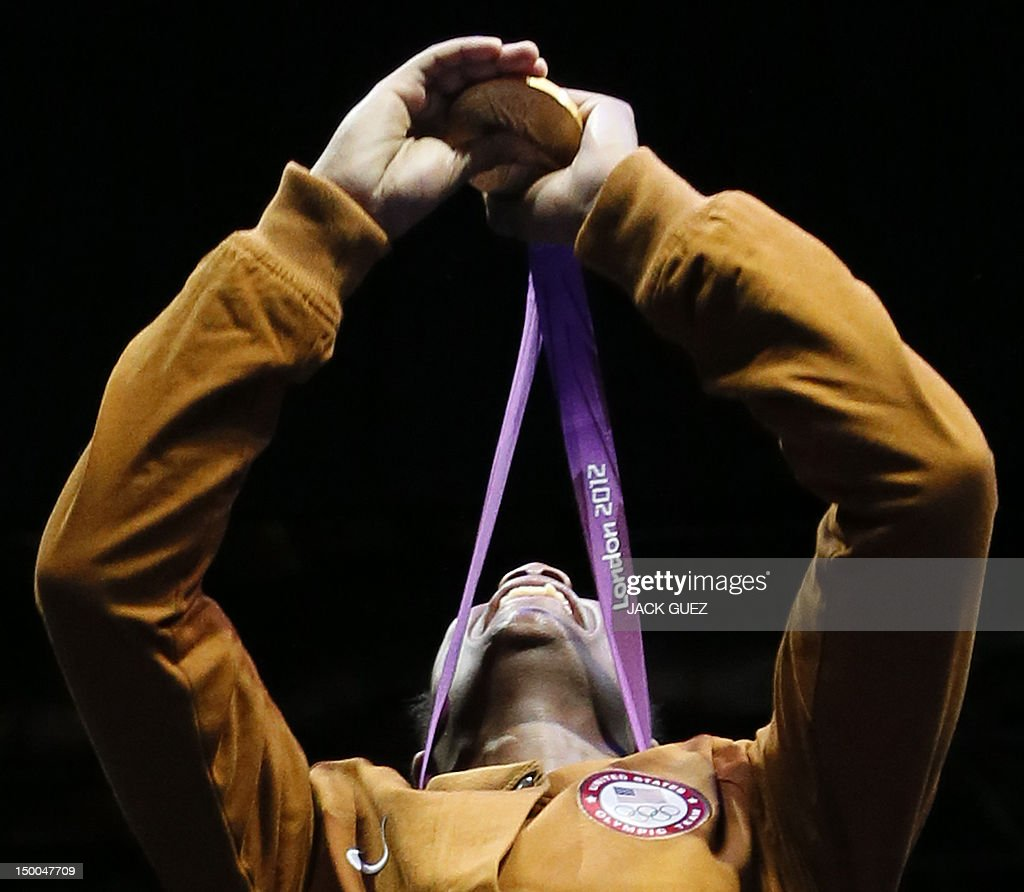Gold medallist Claressa Shields of the USA celebrates her gold medal on the podium during the awards ceremony for the women's boxing Middleweight...
