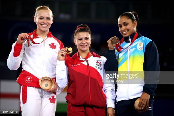 Gold medallist Claudia Fragapane of England poses with silver medallist Elsabeth Black of Canada and bronze medallist Dipa Karmakar of India during...