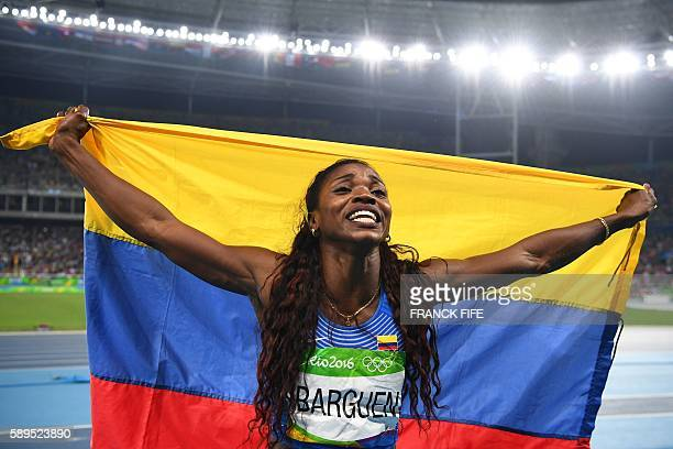 TOPSHOT Gold medallist Colombia's Caterine Ibarguen celebrates winning the Women's Triple Jump Final during the athletics event at the Rio 2016...