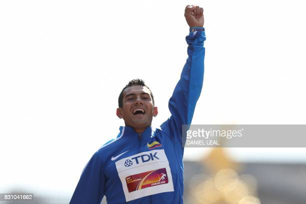 Gold medallist Colombia's Eider Arévalo poses on the podium during the victory ceremony for the men's 20km race walk athletics event at the 2017 IAAF...