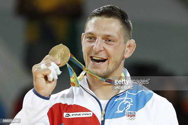 Gold medallist Czech Republic's Lukas Krpalek celebrates on the podium of the men's 100kg judo contest of the Rio 2016 Olympic Games in Rio de...