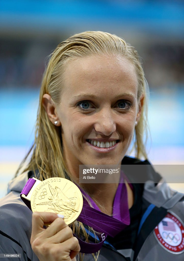 gold medallist <a gi-track='captionPersonalityLinkClicked' href=/galleries/search?phrase=Dana+Vollmer&family=editorial&specificpeople=240582 ng-click='$event.stopPropagation()'>Dana Vollmer</a> of the United States celebrates after winning the gold medal and setting a new world record time of 55.98 seconds in the Women's 100m Butterfly final on Day 2 of the London 2012 Olympic Games at the Aquatics Centre on July 29, 2012 in London, England.