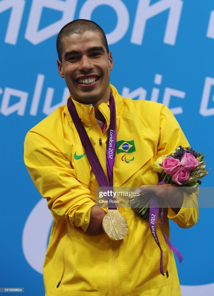 Gold medallist Daniel Dias of Brazil poses on the podium during the medal ceremony for the Men's 50m Freestyle - S5 final on day 1 of the London 2012 Paralympic Games at Aquatics Centre on August 30, 2012 in London, England.