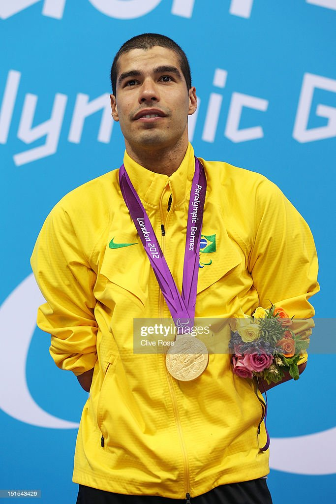 Gold medallist Daniel Dias of Brazil poses on the podium during the medal ceremony for the Men's 100m Freestyle - S5 final on day 10 of the London 2012 Paralympic Games at Aquatics Centre on September 8, 2012 in London, England.
