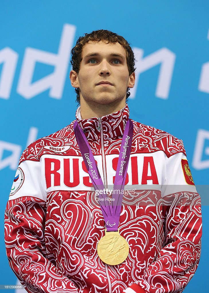 Gold medallist Denis Tarasov of Russia poses on the podium during the medal ceremony for the Men's 50m Freestyle - S8 final on day 5 of the London 2012 Paralympic Games at Aquatics Centre on September 3, 2012 in London, England.