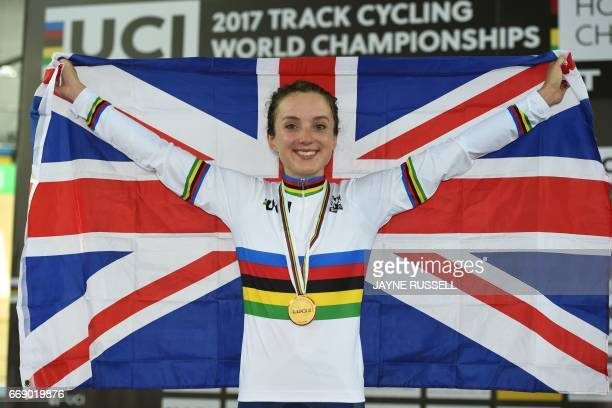 Gold medallist Elinor Barker of Britain poses with the Union Jack flag as she celebrates after the women's points race final at the Hong Kong...