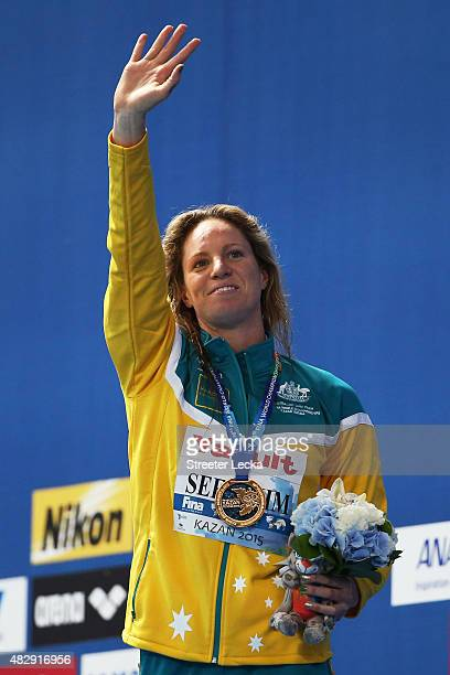 Gold medallist Emily Seebohm of Australia celebrates during the medal ceremony for the Women's 100m Backstroke Final on day eleven of the 16th FINA...