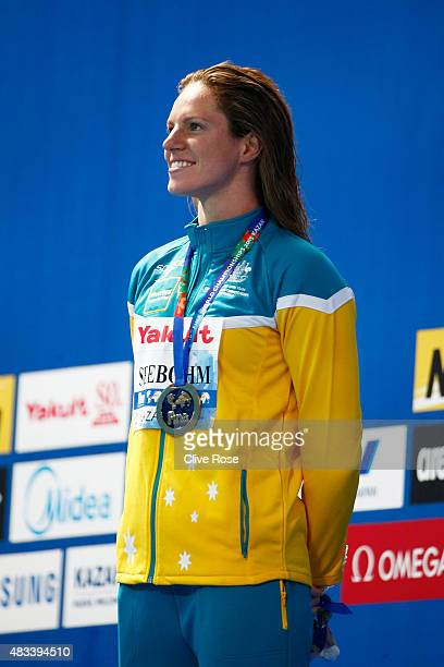 Gold medallist Emily Seebohm of Australia celebrates during the medal ceremony for the Women's 200m Backstroke Final on day fifteen of the 16th FINA...