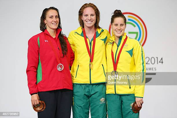 Gold medallist Emily Seebohm of Australia poses with silver medallist Georgia Davies of Wales and bronze medallist Belinda Hocking of Australia...