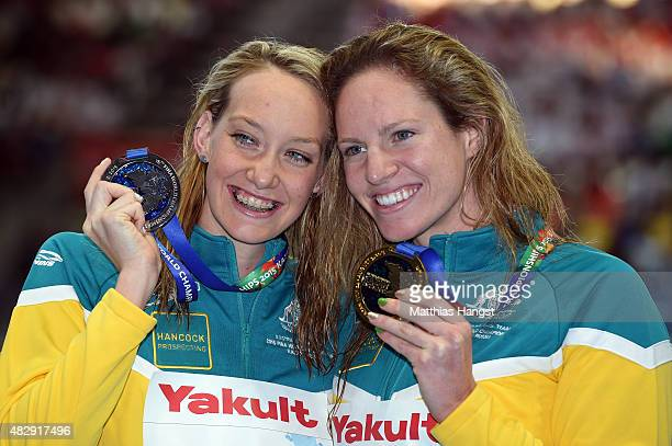 Gold medallist Emily Seebohm of Australia poses with silver medallist Madison Wilson of Australia during the medal ceremony for the Women's 100m...