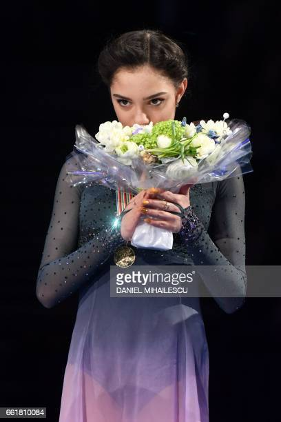 Gold medallist Evgenia Medvedeva of Russia poses with her medal on the podium after the woman's Free Skating event at the ISU World Figure Skating...