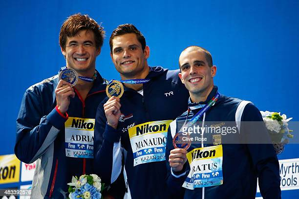 Gold medallist Florent Manaudou of France poses with silver medallist Nathan Adrian of the United States and bronze medallist Bruno Fratus of Brazil...
