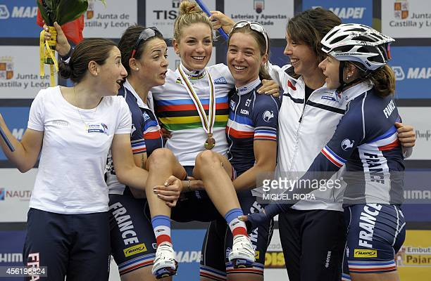 Gold medallist France's Pauline Ferrand Prevot celebrates with her teammates on the podium of the women's road race at the 2014 UCI Road World...