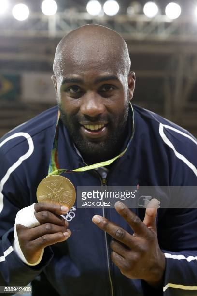 TOPSHOT Gold medallist France's Teddy Riner celebrates with his medal after the podium ceremony of the men's 100kg judo contest of the Rio 2016...
