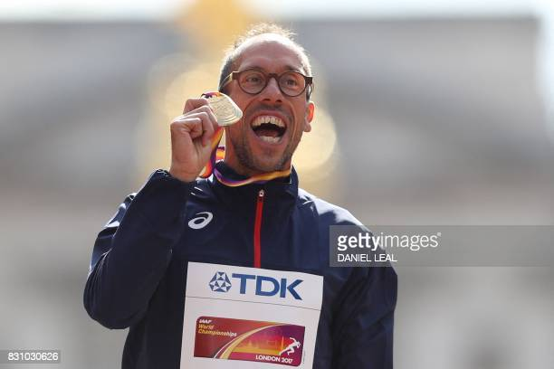 Gold medallist France's Yohann Diniz poses on the podium during the victory ceremony for the men's 50km race walk athletics event at the 2017 IAAF...