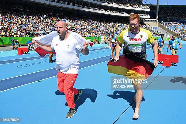 Gold medallist Germany's Christoph Harting and silver medallist Poland's Piotr Malachowski celebrate after the Men's Discus Throw Final during the...