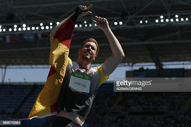 Gold medallist Germany's Christoph Harting celebrates winning the Men's Discus Throw Final during the athletics event at the Rio 2016 Olympic Games...