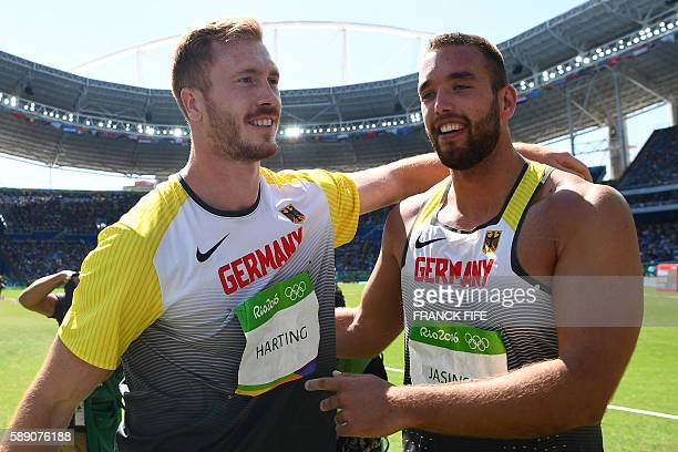Gold medallist Germany's Christoph Harting celebrates with bronze medallist Germany's Daniel Jasinski after the Men's Discus Throw Final during the...