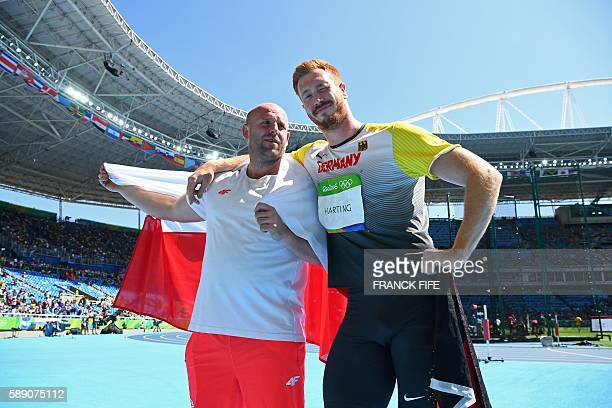 Gold medallist Germany's Christoph Harting celebrates with silver medallist Poland's Piotr Malachowski after the Men's Discus Throw Final during the...
