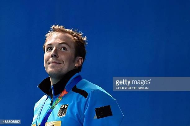 Gold medallist Germany's Marco Koch poses during the podium ceremony of the men's 200m breaststroke swimming event at the 2015 FINA World...