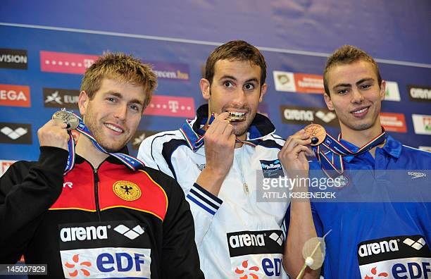 Gold medallist Greece's Aristeidis Grigoriadis silver medallist Germany's Helge Meeuw and bronze medallistIsrael's Yakov Yan Toumarkin celebrate on...
