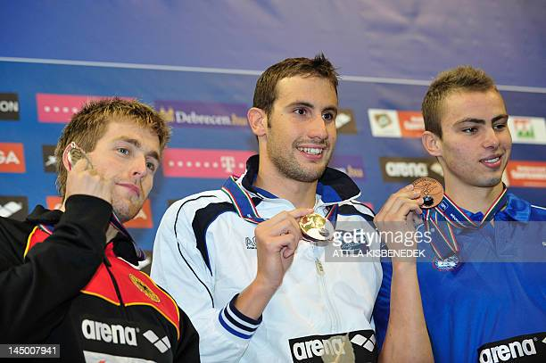 Gold medallist Greece's Aristeidis Grigoriadis silver medallist Germany's Helge Meeuw and bronze medallist Israel's Yakov Yan Toumarkin celebrate on...