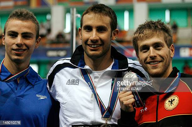 Gold medallist Greece's Aristeidis Grigoriadis silver medallist Germany's Helge Meeuw and bronze medallist Israel's Yakov Yan Toumarkin pose after...