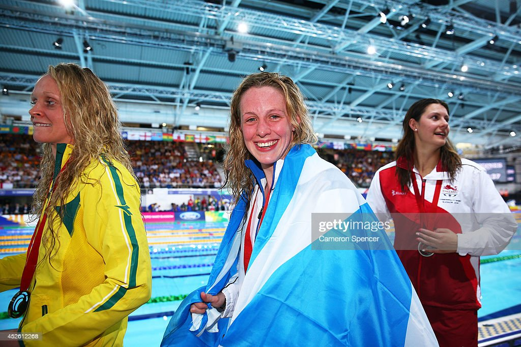 Gold medallist <a gi-track='captionPersonalityLinkClicked' href=/galleries/search?phrase=Hannah+Miley+-+Swimmer&family=editorial&specificpeople=4333059 ng-click='$event.stopPropagation()'>Hannah Miley</a> (C) of Scotland smiles with Silver medallist <a gi-track='captionPersonalityLinkClicked' href=/galleries/search?phrase=Aimee+Willmott&family=editorial&specificpeople=7137431 ng-click='$event.stopPropagation()'>Aimee Willmott</a> (R) of England and Bronze medallist Keryn McMaster of Australia after the medal ceremony for the Women's 400m Individual Medley Final at Tollcross International Swimming Centre during day one of the Glasgow 2014 Commonwealth Games on July 24, 2014 in Glasgow, Scotland.