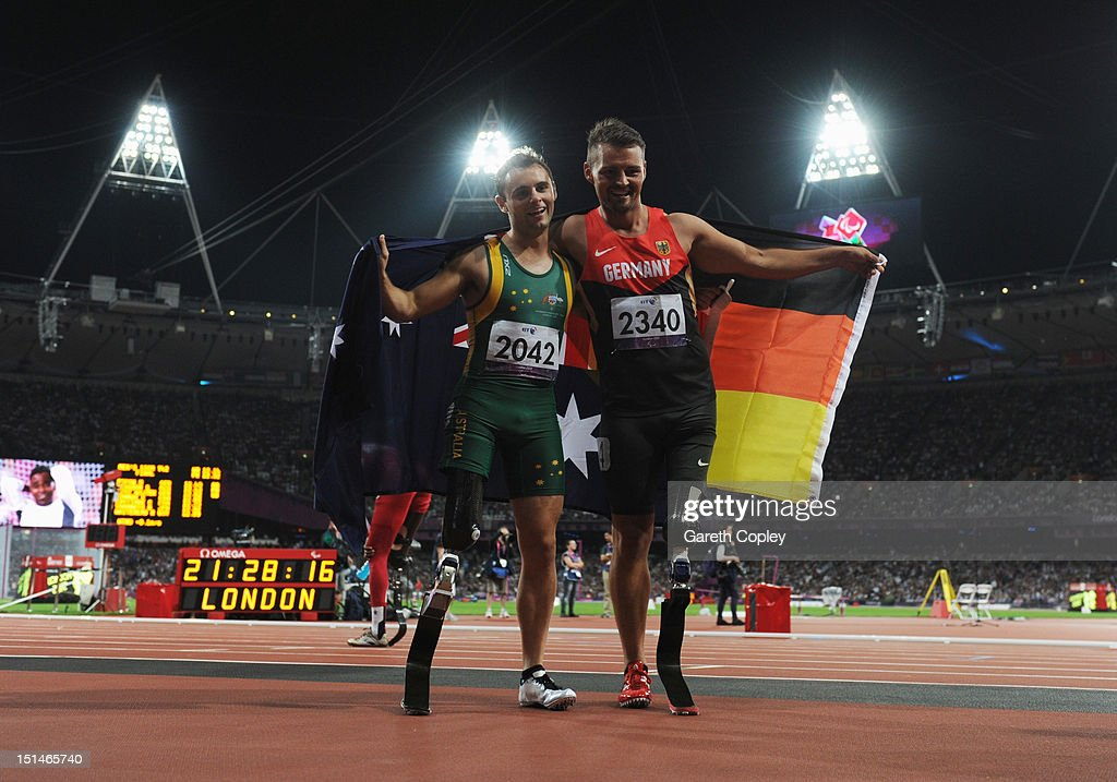 Gold medallist Heinrich Popow of Germany and silver medallist Scott Reardon of Australia celebrate after the Men's 100m T42 on day 9 of the London 2012 Paralympic Games at Olympic Stadium on September 7, 2012 in London, England.