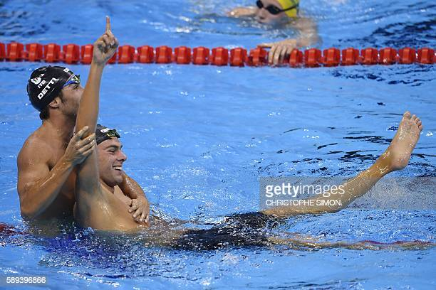 TOPSHOT Gold medallist Italy's Gregorio Paltrinieri celebrates with bronze medallist Italy's Gabriele Detti after winning the Men's swimming 1500m...