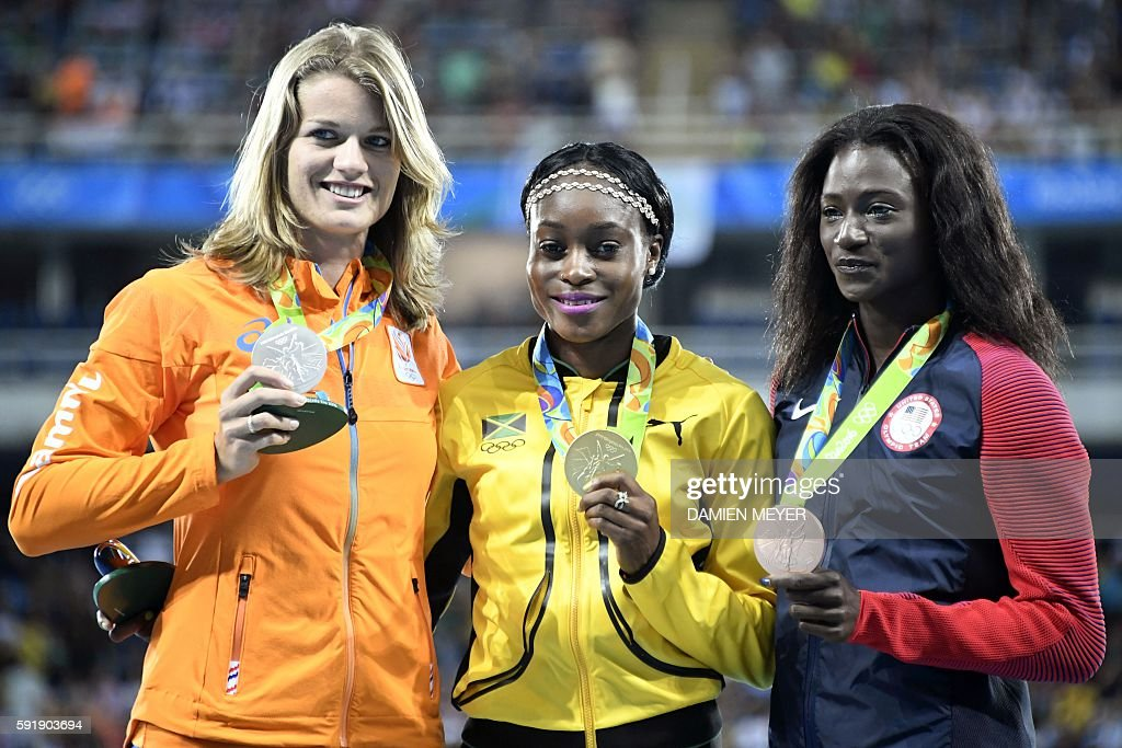 Gold medallist Jamaica's Elaine Thompson poses with silver medallist Netherlands' Dafne Schippers and bronze medallist USA's Tori Bowie on the podium...