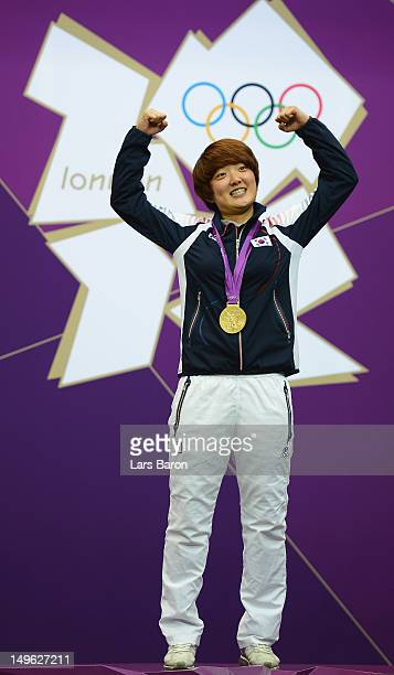 Gold medallist Jangmi Kim of Korea celebrates with her gold medal during the medal ceremony following the Women's 25m Pistol Shooting final on Day 5...