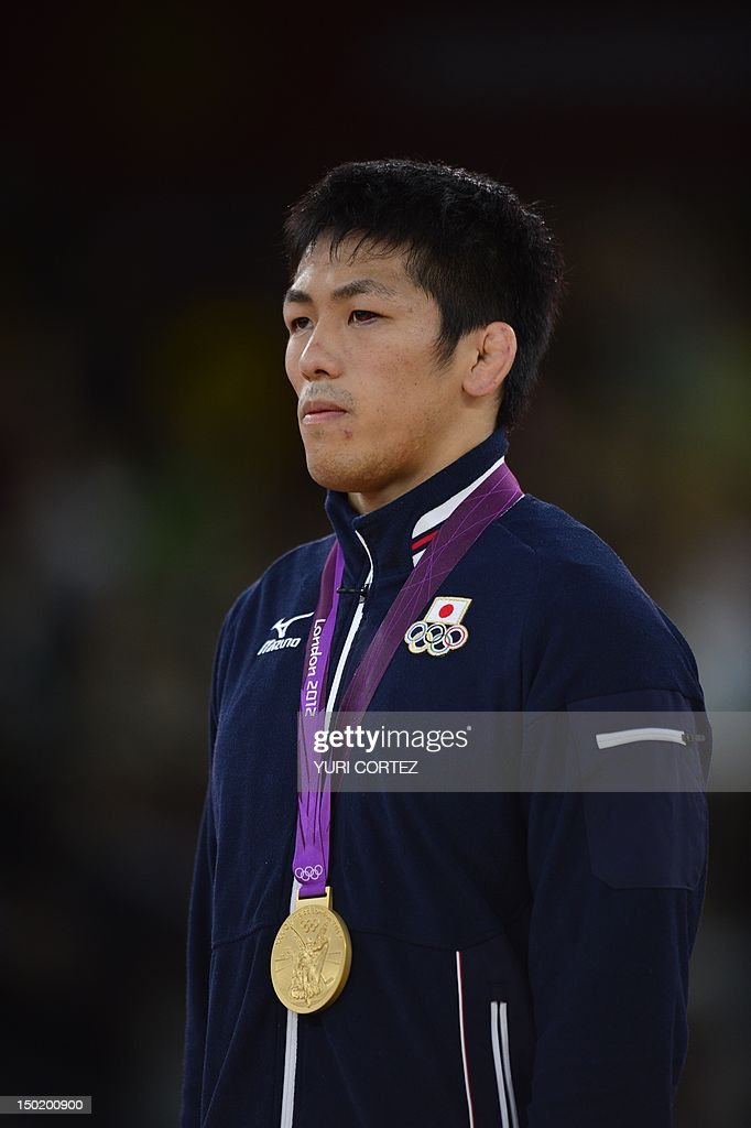 Gold medallist Japan's Tatsuhiro Yonemitsu poses on the podium of the Men's 66kg Freestyle on August 12 2012 during the wrestling event of the London...