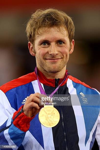 Gold medallist Jason Kenny of Great Britain celebrates during the medal ceremony for the Men's Sprint Track Cycling Final on Day 10 of the London...