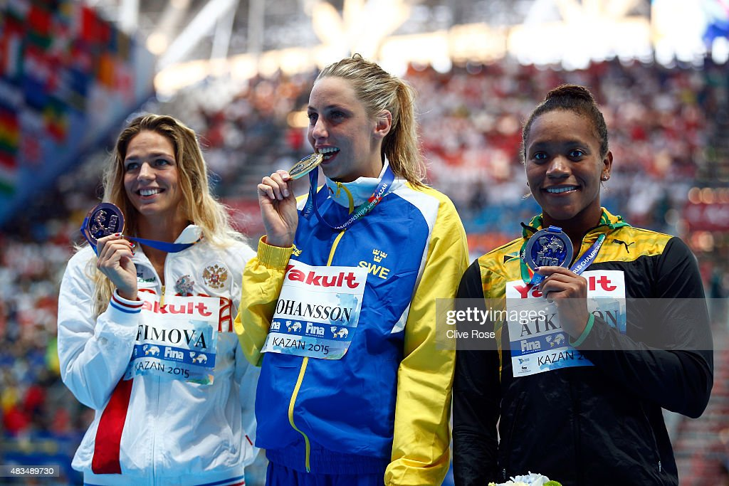 Gold medallist Jennie Johansson of Sweden poses with silver medallist Alia Atkinson of Jamaica and bronze medallist Yuliya Efimova of Russia during the medal ceremony for the Women's 50m Breaststroke Final on day sixteen of the 16th FINA World Championships at the Kazan Arena on August 9, 2015 in Kazan, Russia.